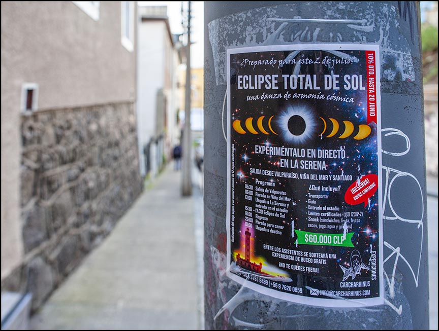 eclipse flyer advertising the eclipse on lampost in Valparaiso