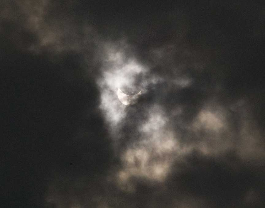 partial phase through clouds before totality